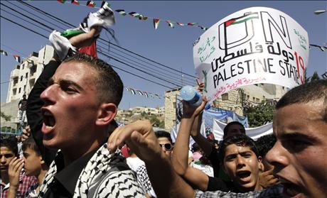 Palestinians take part in a rally in Hebron