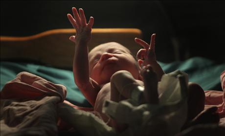 A baby gestures minutes after he was born inside the pediatric unit at hospital Escuela in Tegucigalpa