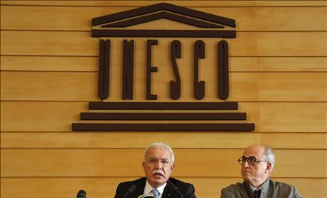 Palestinian Foreign Minister al-Malki and Palestinian ambassador to UNESCO Sanbar attend a press conference during the 36th session of UNESCO's General Conference in Paris - United Nations