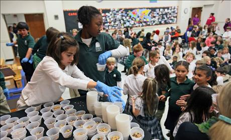 Fourth-grade student Boyd assists with a granola project at Forest Park Elementary School in Little Rock, Arkansas