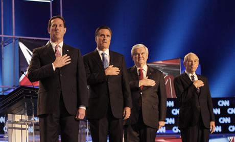 Republican presidential candidates stand on stage before participating in a Republican presidential candidates debate in Charleston 