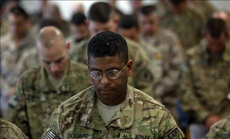Members of US Military praying