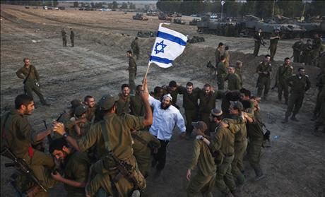 Jewish man holds Israeli flag