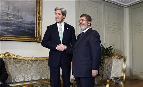 John Kerry with Mohamed Mursi