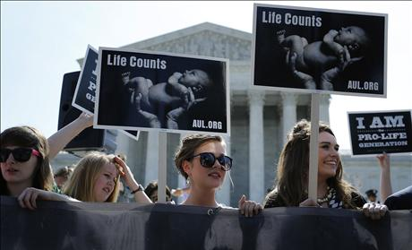 Pro-life demonstrators support Hobby Lobby decision at Supreme Court