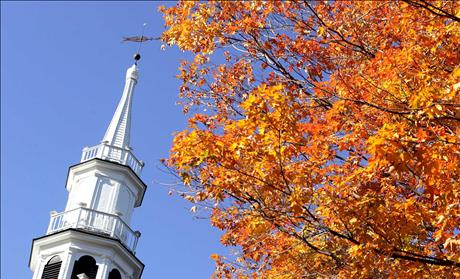 The steeple of The First Congregational Church is juxtaposed with fall colors in Sharon, Connecticut.