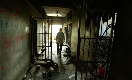 A CORRECTION OFFICER WALKS THROUGH THE CORRIDORS AT THE PRISON. 