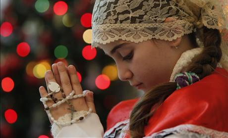 An Iraqi Christian girl attends a Christmas mass at Chaldean Catholic church in Amman