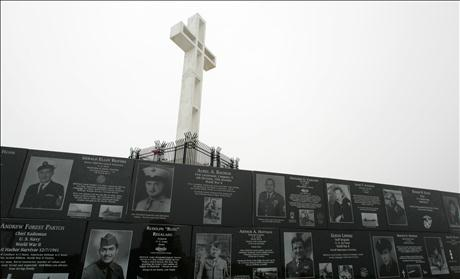 The Mount Soledad cross stands over memorials from the National War Memorial in Ja Jolla, California