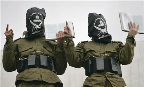 Palestinian militants from al-Aqsa Martyrs Brigades hold copies of the Koran in Nablus