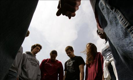 Virginia Tech students and others pray for the victims shot in the Virginia Tech tragedy during a group multi-denominational prayer