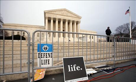 Signs are left behind after a pro-life demonstration at the Supreme Court in Washington