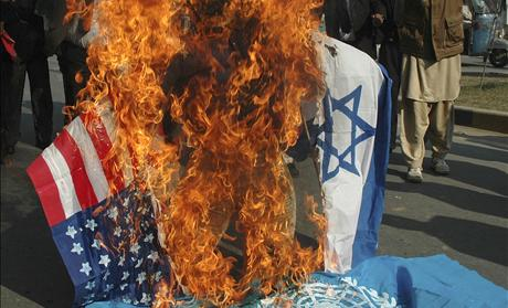 Lawyers burn an effigy of Israel&#39;s PM Olmert along with flags of the US, Israel and the United Nations in Multan, during a protest against the Israeli air strikes on Gaza