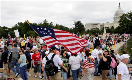 Demonstrators gather on the plaza near the U.S. Capitol to participate in a protest against Obama's fiscal and economic policies in Washington