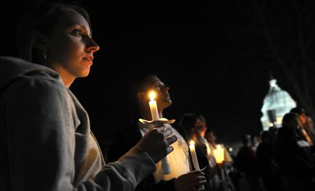 Protestors hold a candlelight vigil as a part of a 'Kill the Bill' rally against Obama's health care legislation, near the US Capitol in Washington
