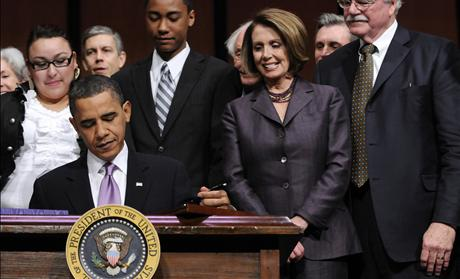 House Speaker Pelosi and Rep. Miller look on as U.S. President Obama signs the Health Care and Education Reconciliation Act into law at Northern Virginia Community College in Alexandria