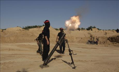 Palestinian militant of the DFLP fires a mortar during a training exercise in Rafah