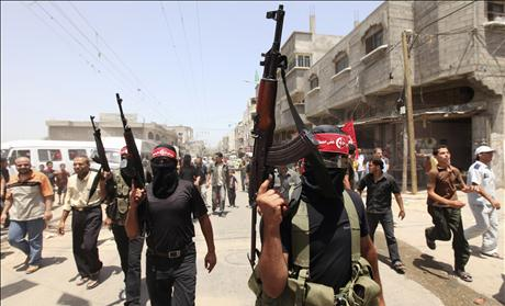 Palestinian militants attend the funeral of Bassam Badwan in Gaza City