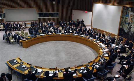 United Nations Security Council diplomats vote on a resolution during a meeting on Libya at U.N. headquarters in New York