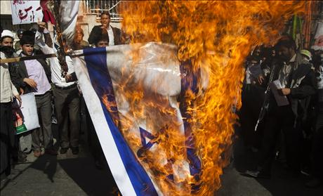 Iranian students burn an Israeli flag during a rally in support of the Bahraini nation in front of Bahrain's embassy in Tehran
