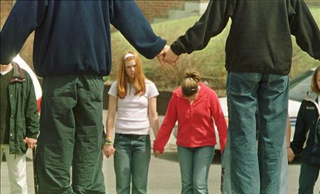 STUDENTS HOLD HANDS IN PRAYER AFTER STABBING AT HIGH SCHOOL.