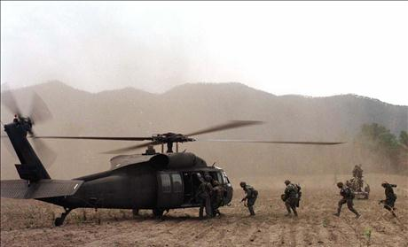 U.S. SOLDIERS RUN TO BOARD A HELICOPTER DURING EXERCISE