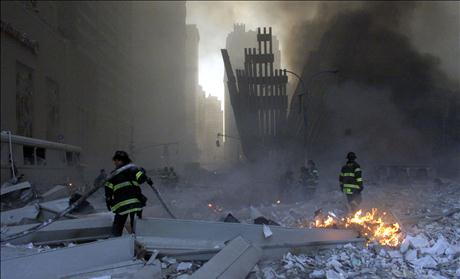 RESCUE CREWS LOOK AT WORLD TRADE CENTER DAMAGE.