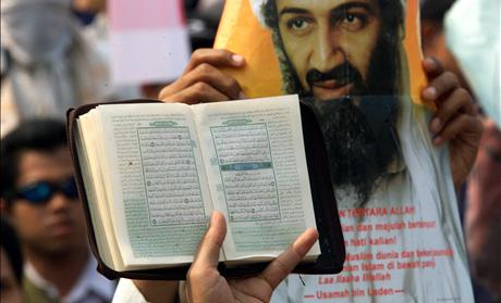 A COPY OF THE KORAN IS HELD UP DURING A AN ANTI-US RALLY IN JAKARTA.