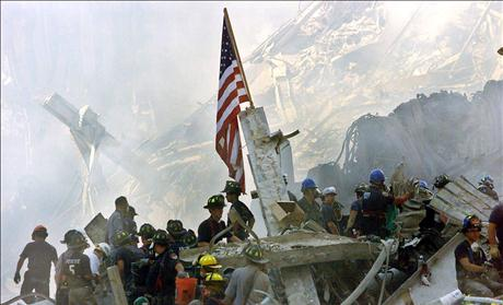 A U.S. flag is posted in the rubble of the World Trade Center September 13, 2001, in New York.