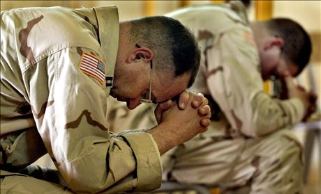 United States Army Chaplain Tim Meader (L) and Chaplain William Lovell, both from Fort Carson, Colorado
