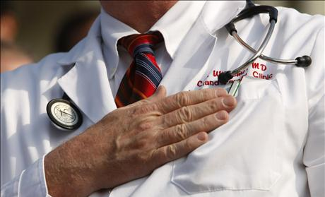 A doctor puts his hand over his chest during a &quot;House call&quot; rally against proposed healthcare reform legislation at the Capitol in Washington