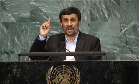 Iran's President Ahmadinejad gestures as he addresses the 65th United Nations General Assembly at U.N. headquarters in New York