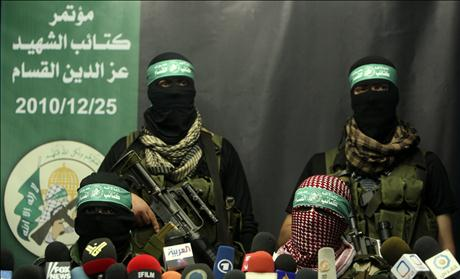 Members of Al-Qassam brigades, the armed wing of the Hamas movement, take part in a news conference in Gaza City