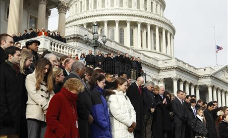 Members of Congress and other Capitol Hill staffers observe a moment of silence on the steps of the U.S. Capitol for Arizona Congresswoman Gabrielle Giffords in Washington