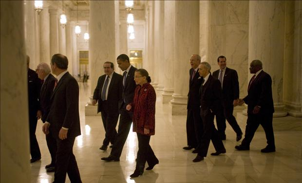U.S. President-elect Obama walks with Supreme Court justices during a visit to the U.S. Supreme Court in Washington
