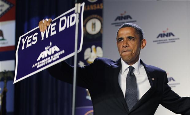U.S. President Barack Obama holds up a sign at the American Nurses Association house of delegates meeting in Washington