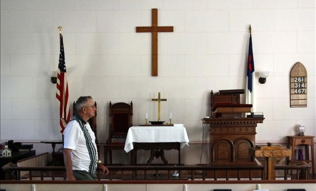 Howard Grace walks through the West Unity Community United Methodist Church before joining the weekly Bible study group in Unity