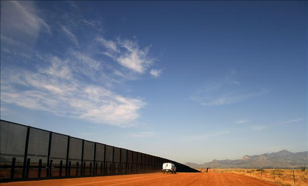 A U.S. Border vehicle drives along the U.S. and Mexico border fence in Naco, Arizona