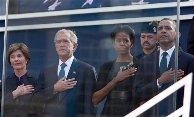 U.S. President Barack Obama, first lady Michelle Obama, former president George W. Bush (2nd L) and Laura Bush salute the flag during tenth anniversary ceremonies at the National September 11 Memorial at the World Trade Center site in New York, September 11, 2011. The 9/11 attacks changed life in the United States forever, but 10 years after the devastating hit, New Yorkers have learned to live in a more dangerous world and are ready to move on.
