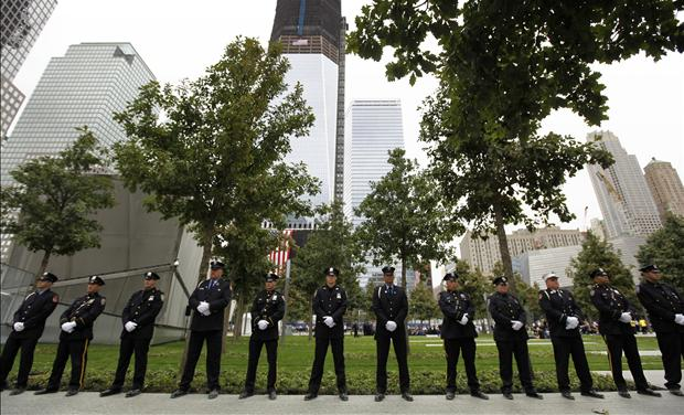 NYPD officers, FDNY firefighters and Port Authority Police line up at one of the entrances of 9/11 Memorial Plaza during ceremonies marking the 10th anniversary of the 9/11 attacks on the World Trade Center, in New York, September 11, 2011.