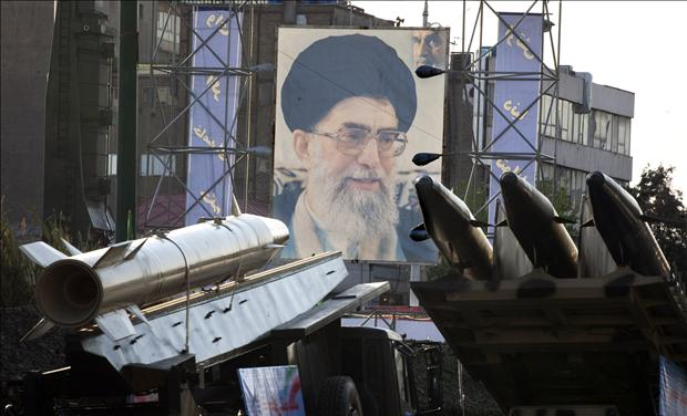 Iranian-made Fateh 110 and Persian Gulf missiles are seen next to portrait of Iran's Supreme Leader Ayatollah Khamenei at Baharestan square in southern Tehran