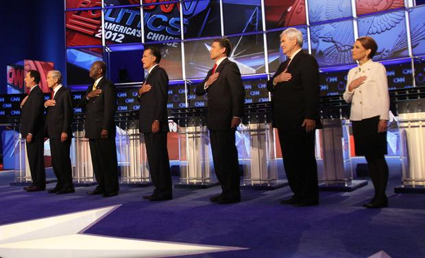 Republican presidential candidates listen to the national anthem before the start of the Republican Presidential Debate in Las Vegas
