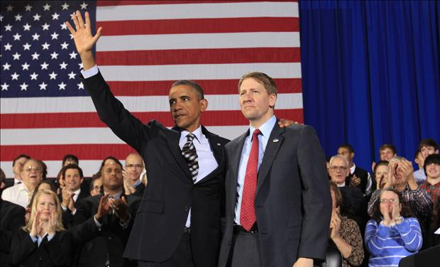 U.S. President Obama waves with Cordray during a trip Cleveland