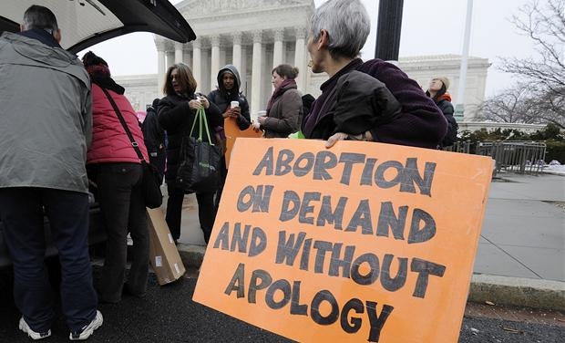 Abortion rights protestors arrive to prepare for a counter protest against March for Life anti-abortion demonstrators on the 39th anniversary of the Roe vs Wade decision, in front of the U.S. Supreme Court building in Washington