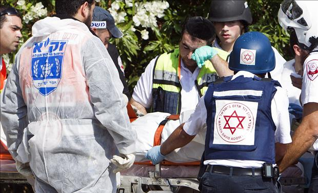 Israeli medics after rocket attack