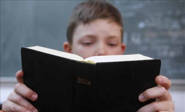 Child holding Bible