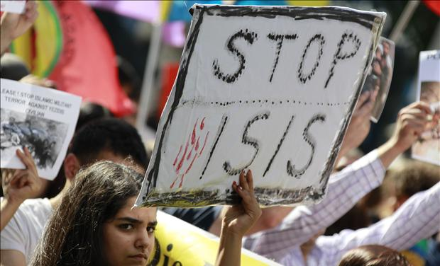 Iraqi Hold sign to Stop ISIS