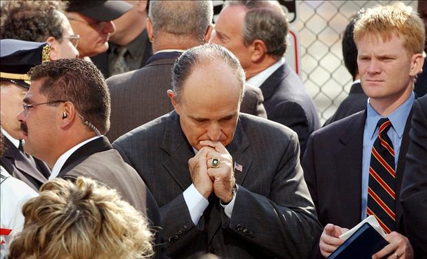 FORMER NEW YORK MAYOR GIULIANI PAUSES DURING CEREMONIES MARKING SEPTEMBER 11 ATTACKS.