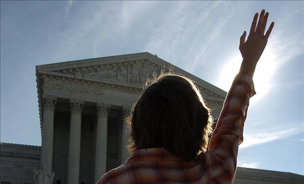 Anti-abortion advocate stands in prayer in front of Supreme Court in Washington DC