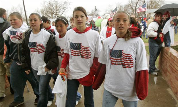 Students wearing t-shirts with U.S. flag arrive at school in Westminster